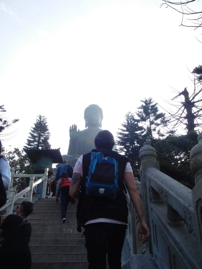 Simone climbing the stairs to Big Buddha