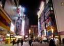 Night view of Akihabara Street with neon buildings where you can buy anime merch and play video games