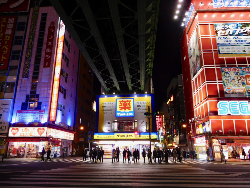 Street in Akihabara at night with neon buildings in Tokyo