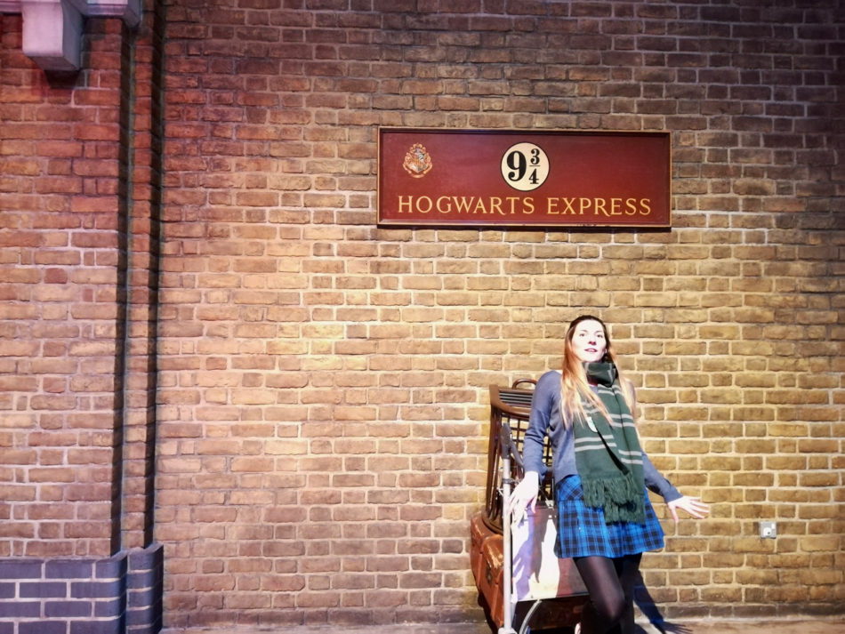 Alice falling back on Platform 9 34 at the Harry Potter Warner Bros Studio