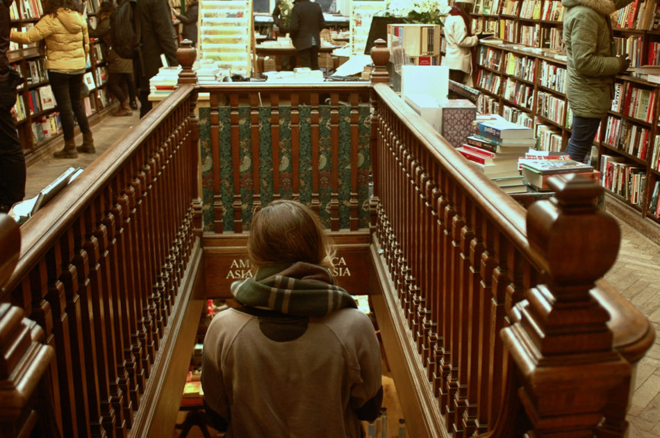 Alice in front of the stairs in Daunt Books during our Harry Potter weekend in London