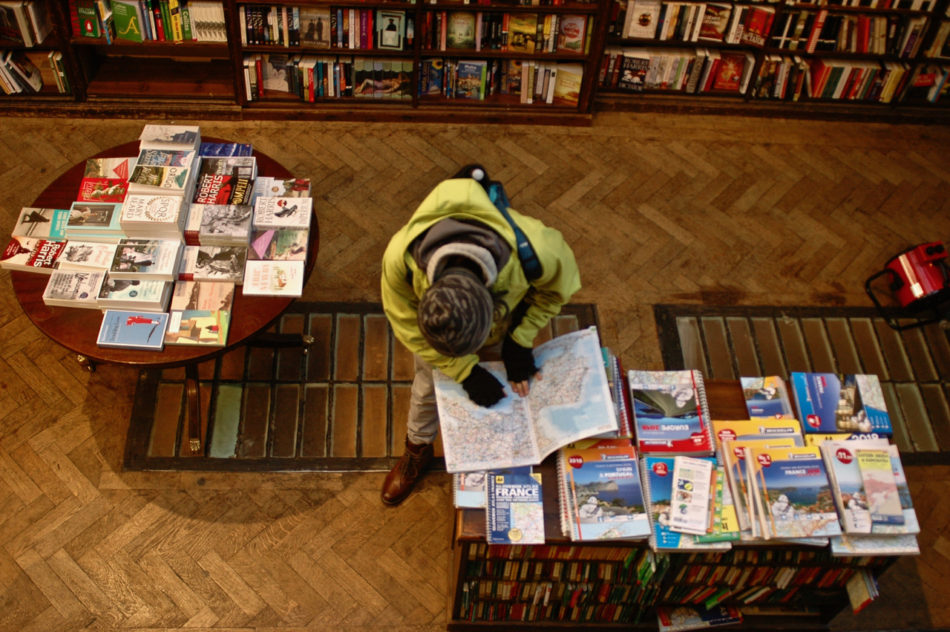 Simone looking at a map at Daunt Books