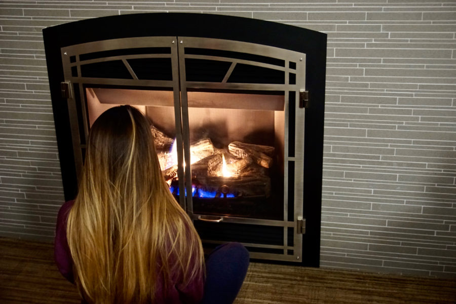 Alice in front of the fireplace at Hotel Chateau Laurier in Québec