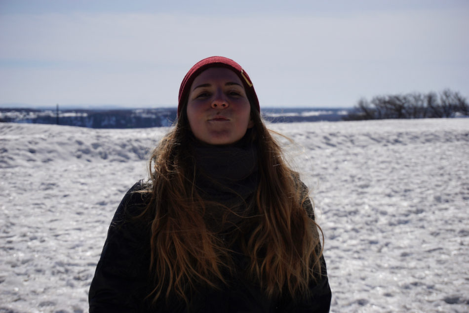 Alice on a field covered with snow at the Park of Montmorency Falls in Québec