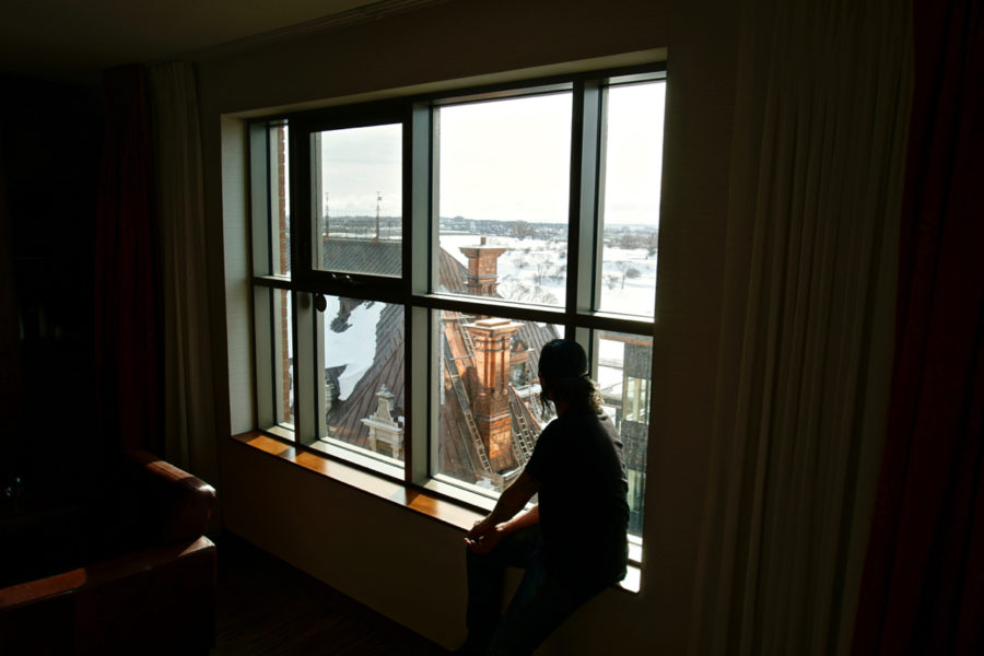 Simone sitting on the window still watching the view from Hôtel Château Laurier