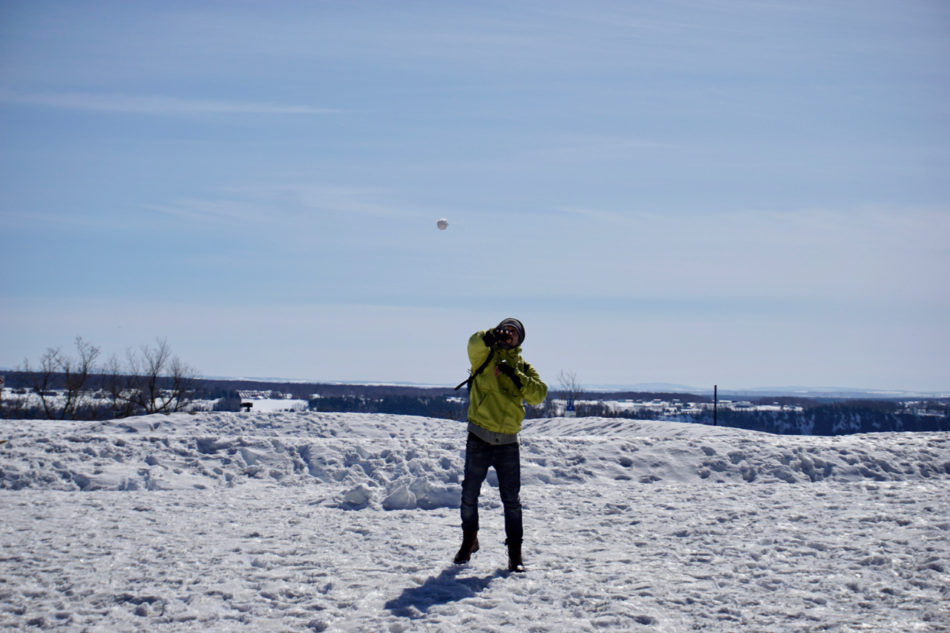 Simone throwing a snowball at Montmorency Falls in Québec