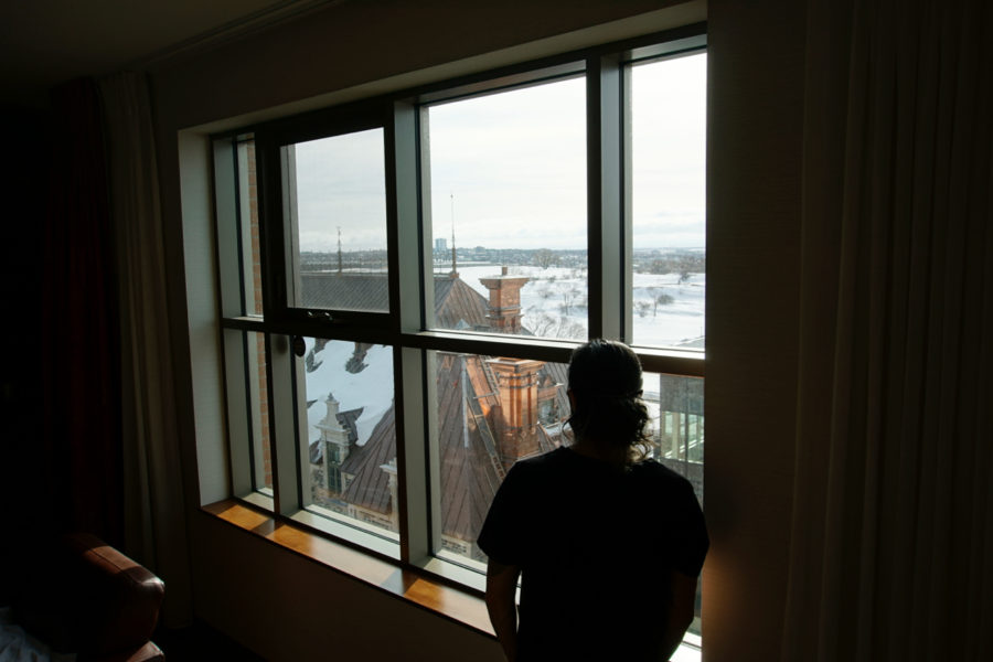 Simone watching the view from our Luxueuse room in Hôtel Château Laurier in Québec city