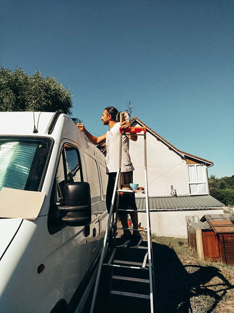 Simone taking care of our converted van in Auvergne, France