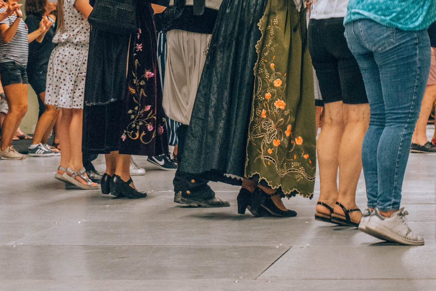 Feet of people wearing tradition outfits and dancing at a fest-noz at the Inter-Celtic Festival in Lorient