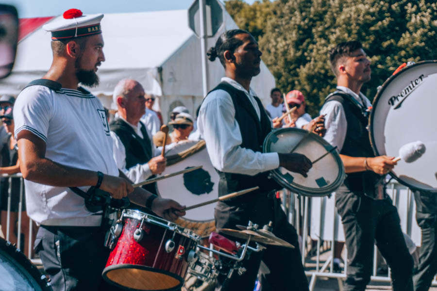 Men playing traditional drums during the Grand Parade at the Inter-Celtic Festival in Lorient