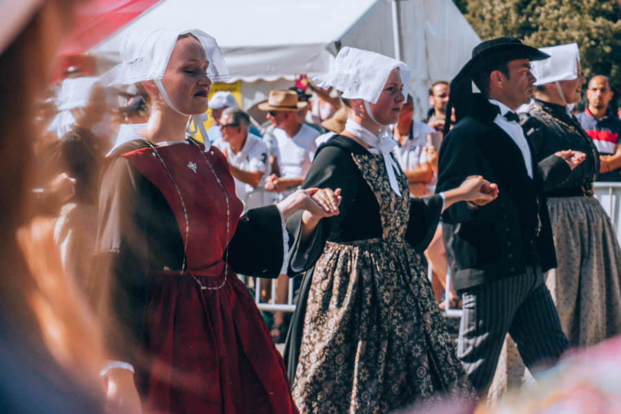 Women in traditional outfits at the Grand Parade at the Inter-Celtic Festival in Lorient