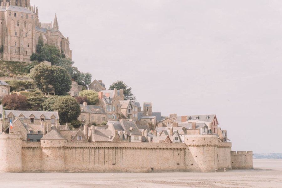 View of the village of the Mont Saint Michel when you arrive on the bridge to the island