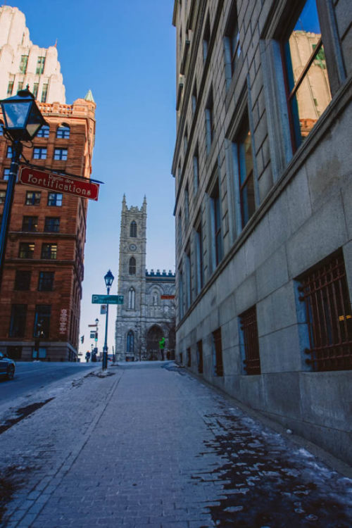 Arriving in Old Town Montreal in March by the street of fortifications