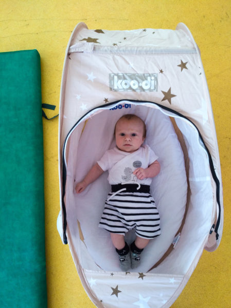 Using the Koo-di travel bassinet at yoga class