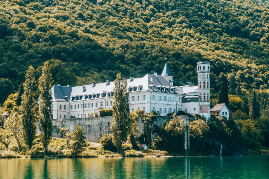 The abbey standing tall above the water of the Lake Bourget in Aix les Bains