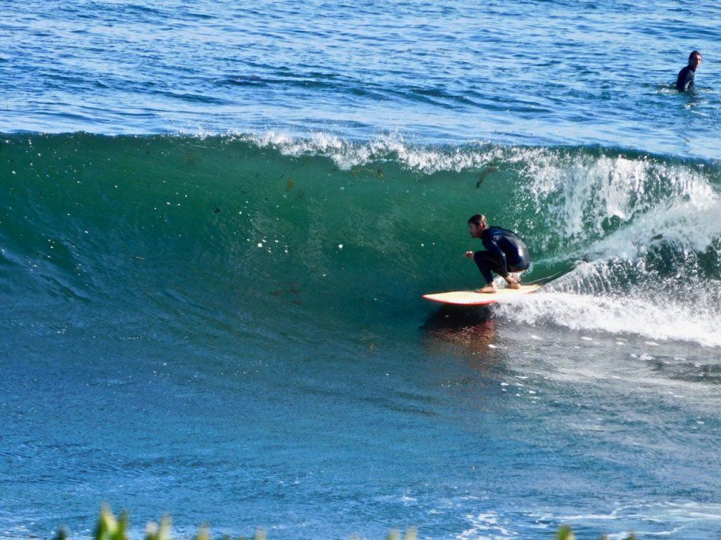Taking a wave in Santa Cruz