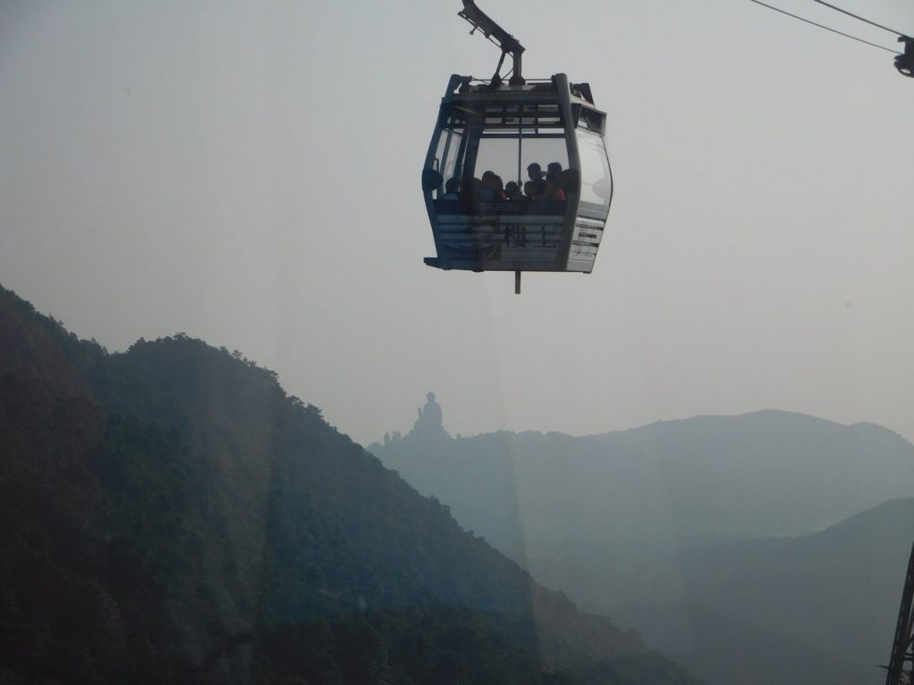 cable car with big buddha
