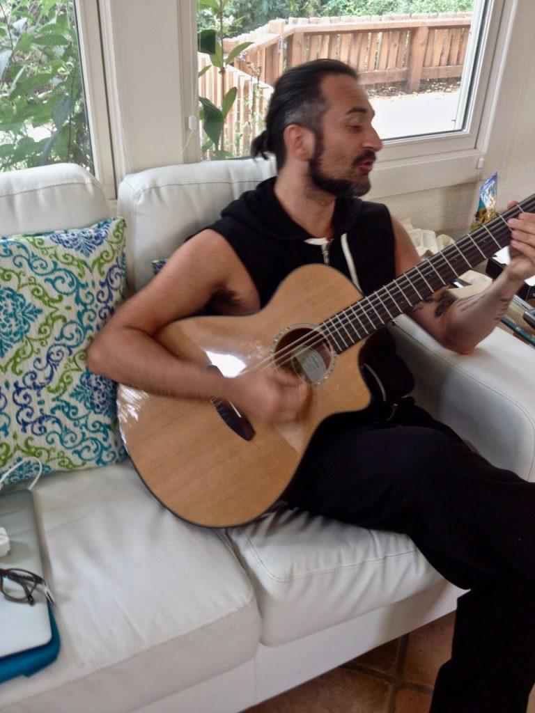 Simone playing Guitar