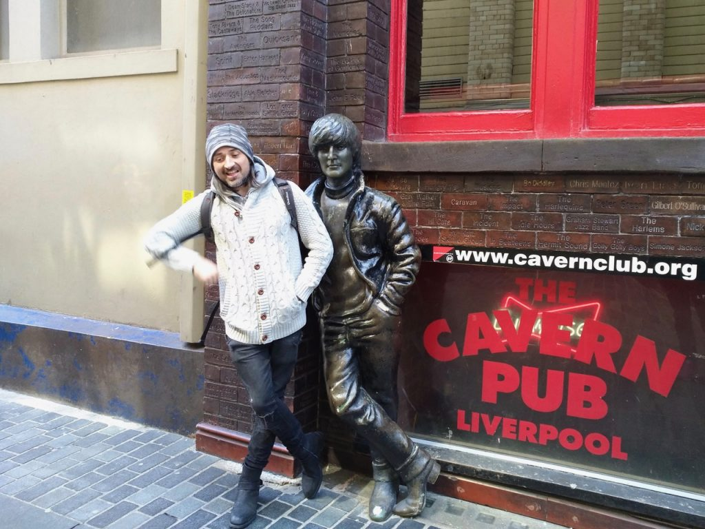 Simone with a statue in front of cavern pub