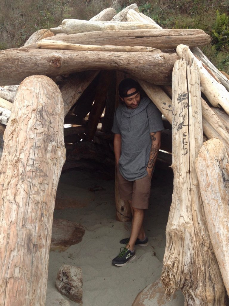 Simone in a wood teppee on the beach in Mendocino