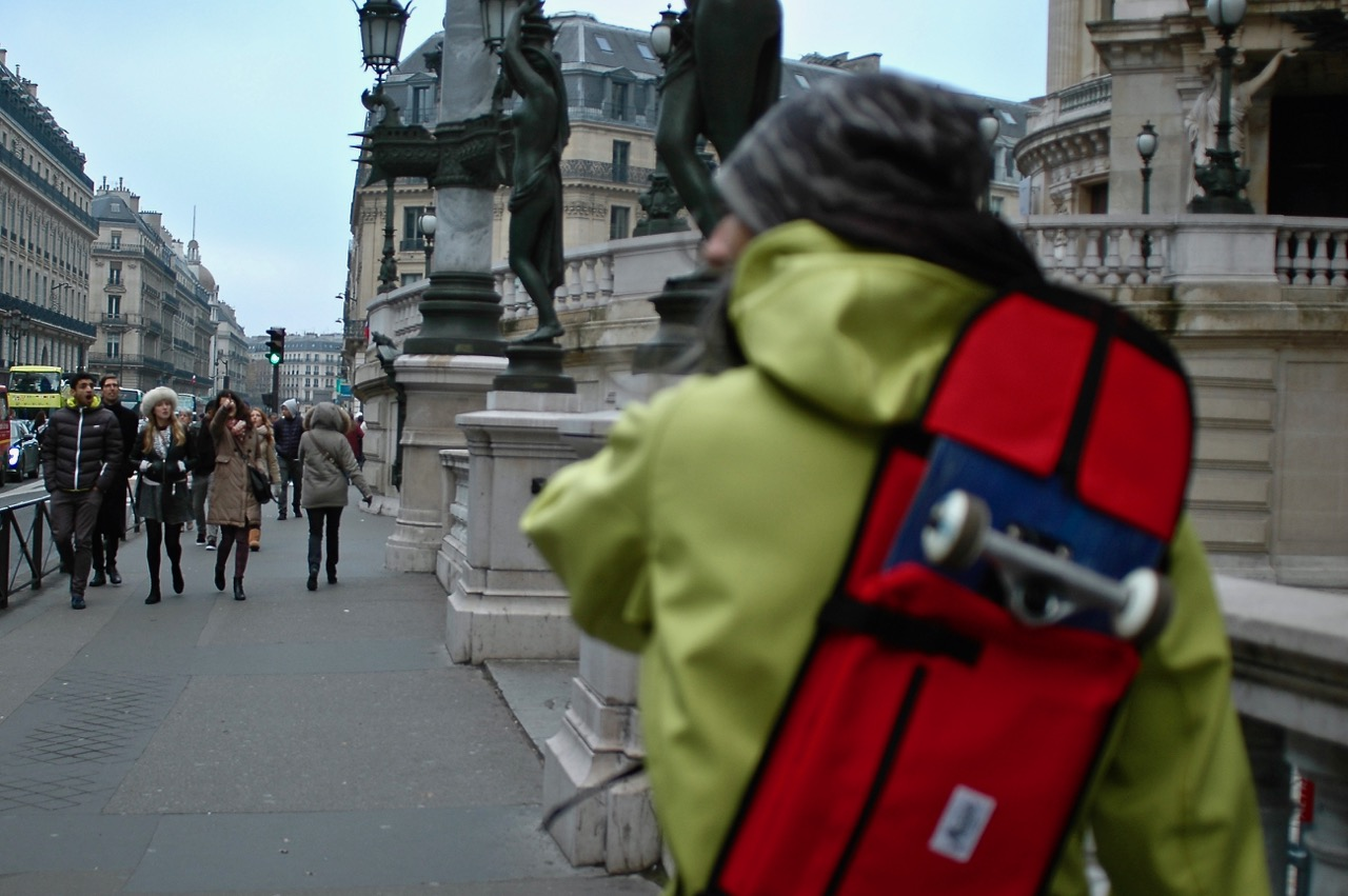 Simone on the way to the Louvre with his skateboard bag