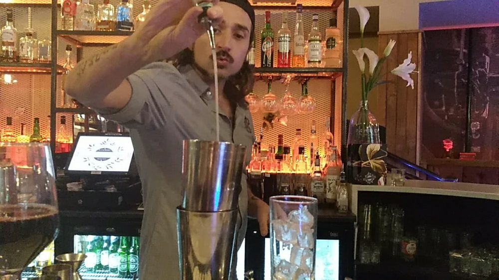 Simone working at Marcus Ward bar Belfast 2017