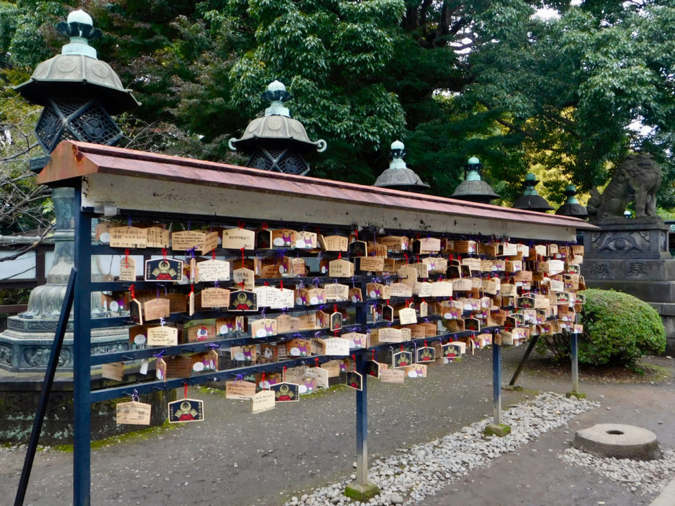 Wooden cardboards with prayers on them in the temple area of Ueno Park in Tokyo