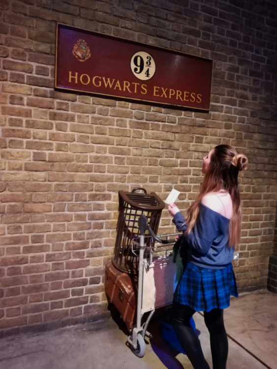 Alice checking out Platform 9 34 at Harry Potter Studio in London