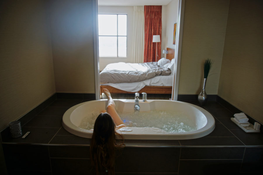 Alice in the jacuzzi with a view of our room at Hôtel Château Laurier