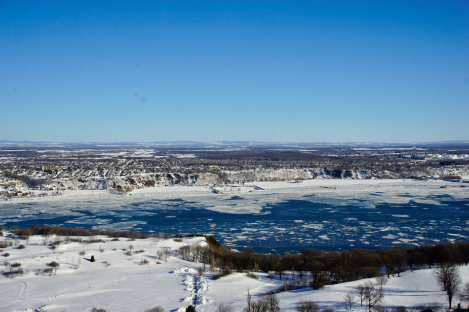 Beautiful snowy view of the Saint-Lawrence river in Québec city from the Observatory