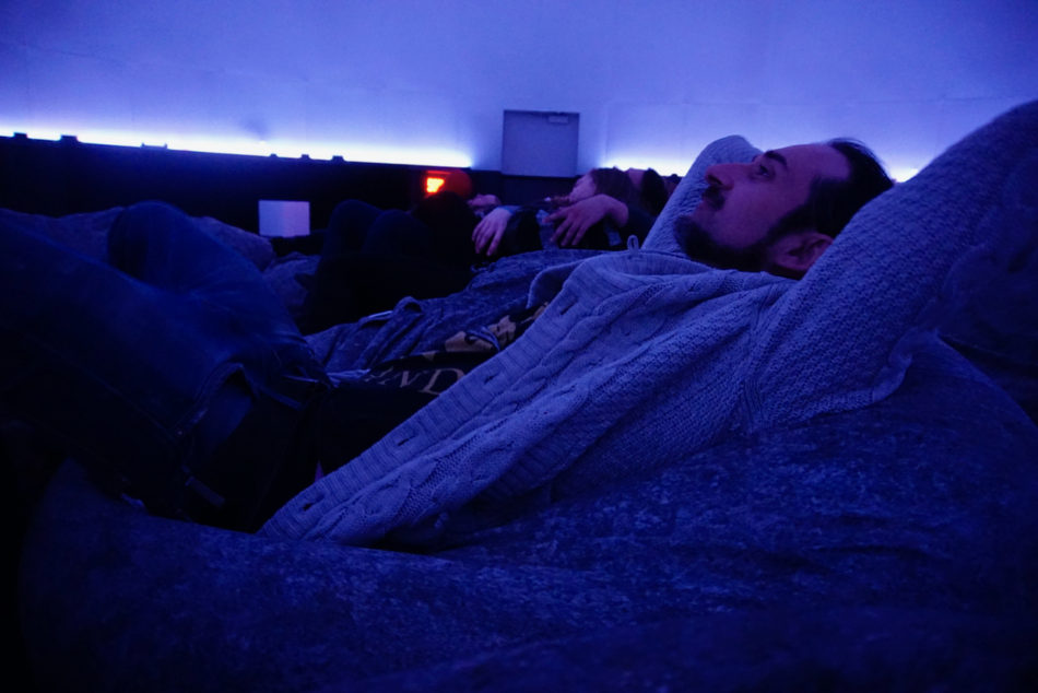 Simone watching the first film at the Montreal Planetarium