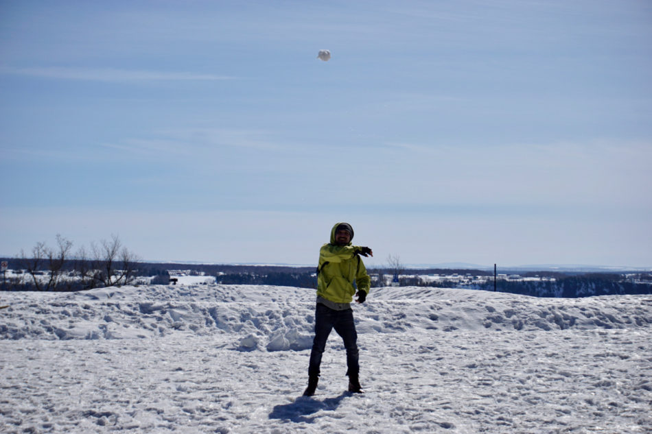 Simone playing with a snow ball at the Montmorency Falls Park in Québec