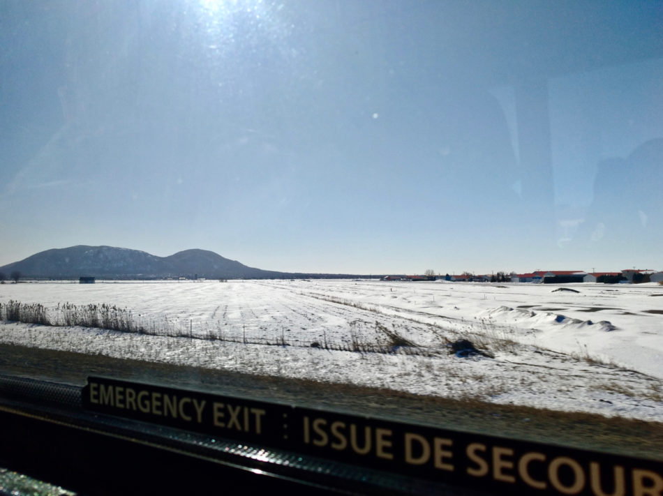 Winter wonderland fields of snow on the way to Québec from Montréal by bus with Orléans Express