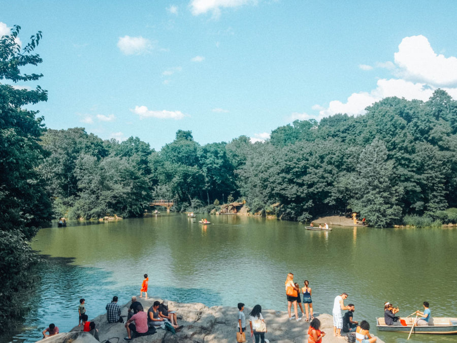 Off the beaten path things to do in NYC Watching people seating on a rock in Central Park
