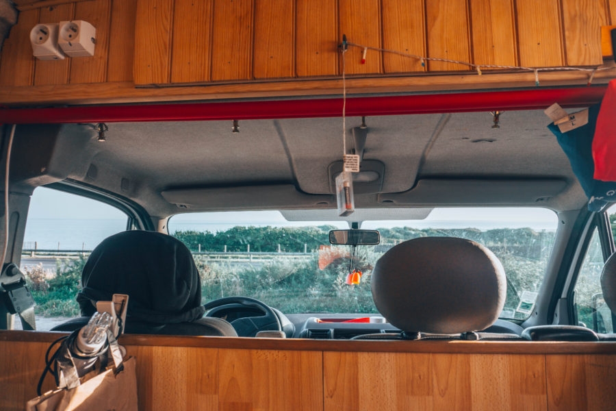 The inside of our camper van on a road trip in Brittany, France