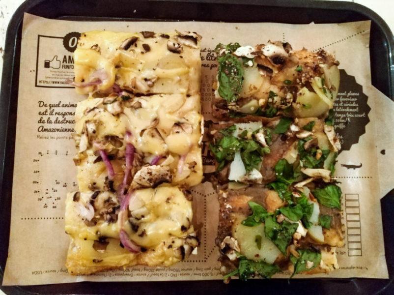 Vegan pizza pieces at my favorite vegan pizzeria in Paris