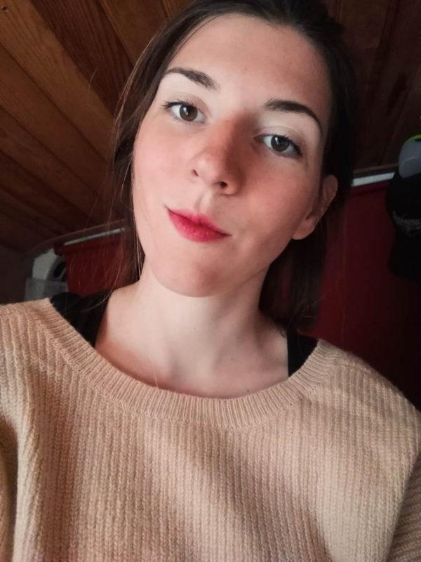 Alice in our van wearing a sweatshirt in Dijon