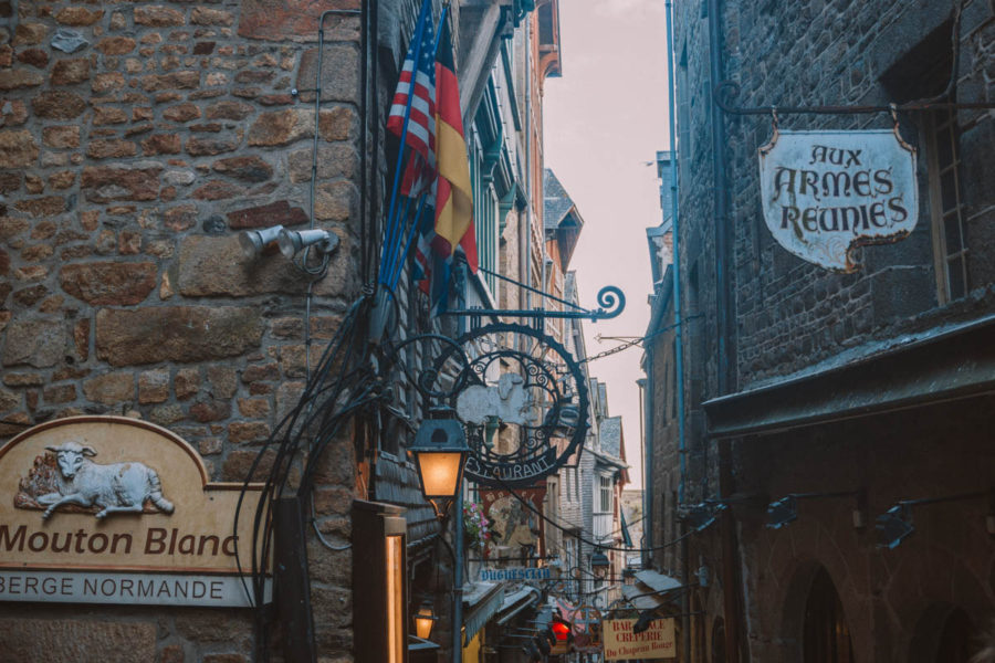 The little shops and restaurants in the Grand Rue of the Mont Saint Michel in the evening