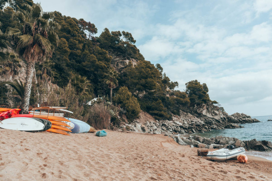 Kayaks on the beach in Tossa de Mar Spain