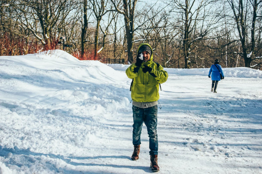 Simone throwing a snow ball in Mont Royal in Montreal in March
