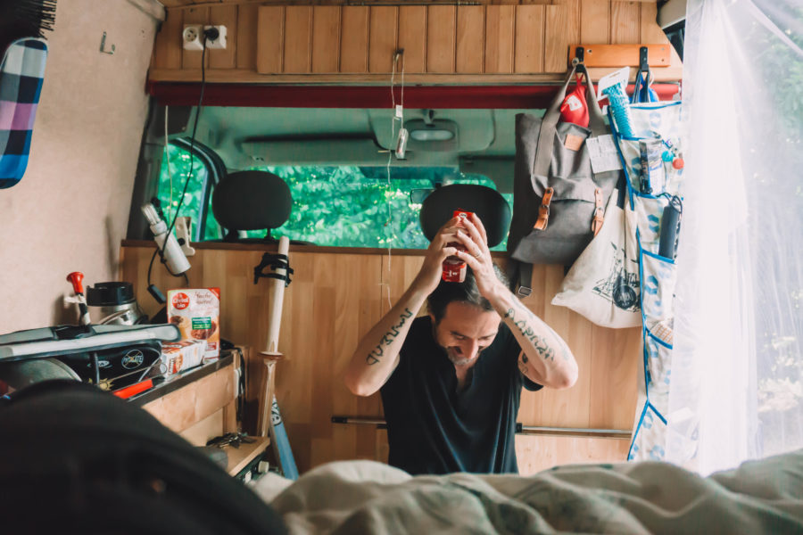 Hanging storage and mosquito net in our van life essentials