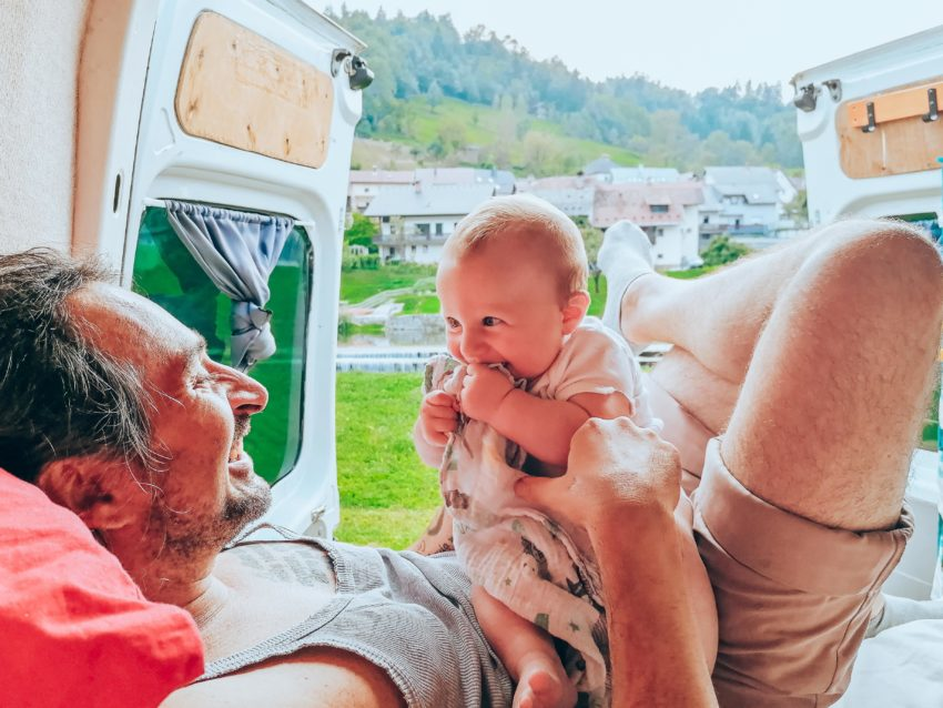 Hanging with baby in camper van on road trip in Slovenia